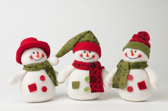 Christmas Snowmen. Three snowmen on a white  background Stock Image
