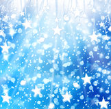 Christmas snowy background with blue stars Stock Photo