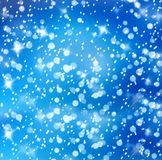 Christmas snowy background with blue stars Royalty Free Stock Images