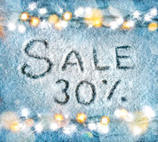 Christmas snowy background with garland. Sale 30 percent off. Christmas snowy background with garland. Top View. Merry Christmas and Happy New Year discount Royalty Free Stock Images