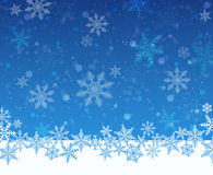 Christmas snowy blue background with defocused elements. Royalty Free Stock Photos