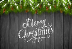 Christmas snowy decorations on black wooden background Stock Images