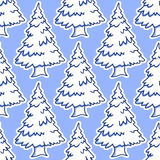 Christmas snowy pine and fir tree seamless pattern. Christmas tree seamless pattern. Winter forest landscape with pine and fir tree, covered with snow on blue Royalty Free Stock Photos