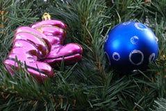 Christmas soccer. Santa shoes and blue ball Stock Photos