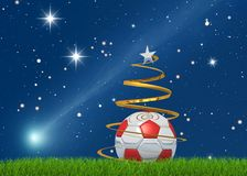 Christmas soccerball and comet. Marry christmas from the world of the soccer on starry background Royalty Free Stock Photography