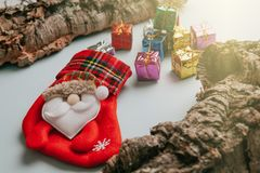 Christmas sock with bunch of gifts getting out from it. Royalty Free Stock Photography