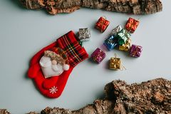Christmas sock with bunch of gifts getting out from it. Stock Images