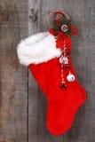 Christmas sock and decoration on wood Stock Image