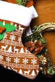Christmas sock deer, wreath with decoration. Tree branch on wooden background royalty free stock image