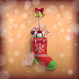 Christmas sock with gifts suspenden on the wall Stock Image