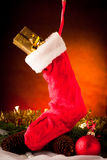 Christmas sock hanging over ornament arrangement Royalty Free Stock Photos