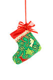 Christmas sock hanging over white background. Stock Photo
