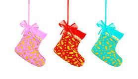 Christmas sock hanging over white background, pink red and blue Royalty Free Stock Images