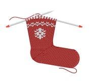 Christmas Sock Knitting on the needles. Christmas red sock knitting on the needles Royalty Free Stock Images