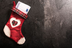 Christmas sock with money Stock Photos