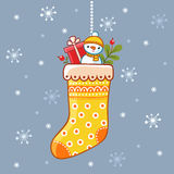 Christmas sock with presents inside. Royalty Free Stock Photos