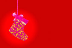 Christmas sock on red background, clipping path Stock Photos