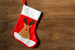 Christmas Sock with Reindeer on wooden background. Christmas Sock with Reindeer on natural wooden background Stock Photos