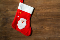 Christmas Sock with Santa on wooden background. Christmas Sock with Santa on natural wooden background Royalty Free Stock Image