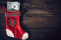Christmas sock stuffed with money Stock Photography