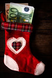 Christmas sock stuffed with money Stock Image