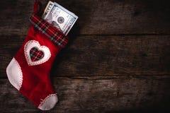 Christmas sock. Traditional Christmas sock stuffed with the money stock photo