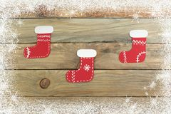 Christmas sock on wooden background with blank space for ads. Top view. stock photo