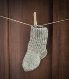 Christmas sock on the wooden background. Stock Images
