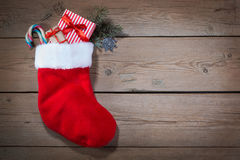 Christmas sock on wooden Royalty Free Stock Photos