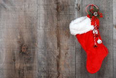 Christmas sock and wreath on wood Stock Photo