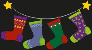 Christmas socks. Colorful christmas socks hanged up and waiting for gifts Royalty Free Stock Images