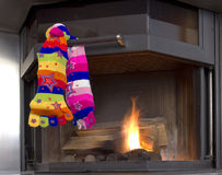 Christmas socks. Two coloured socks hang by the fireplace, filled with candies Stock Photography