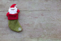 Christmas socks and Christmas decoration on white wooden backgro Stock Photos