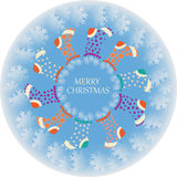 Christmas socks in the circle of snowflakes. Stock Photography