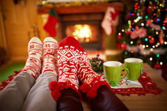 Christmas socks concept. Worm Christmas socks front fireplace Royalty Free Stock Images