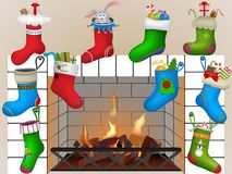 Christmas socks by the fireplace. Vector illustration Stock Images