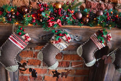 Christmas socks gift. Box for family. Hang on the fireplace decoration closeup Stock Photo