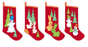 Christmas socks for gifts. With bunnies, Christmas trees and snowmen Royalty Free Stock Photography