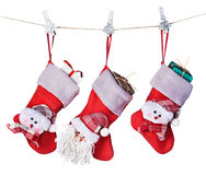 Christmas socks with gifts hanging Stock Images
