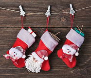 Christmas socks with gifts hanging Royalty Free Stock Photos