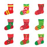 Christmas socks gifts icons ornamental decoration. Christmas socks for Happy New Year and Christmas Winter Holiday. Socks icons set, with snowflakes, santa Stock Photography