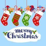 Christmas socks with gifts and lettering - merry christmas.  Royalty Free Stock Photos