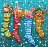 Christmas socks with gifts and toys. And a garland Stock Photography
