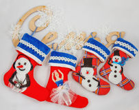 Christmas socks. 4 socks for gifts Christmas socks on wooden decorative inscriptions: Family Stock Photography