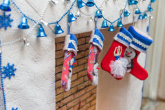 Christmas socks. Hanging on a decorative fireplace Stock Images