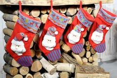Christmas socks hanging on fireplace. Christmas socks hanging on decorative fireplace Royalty Free Stock Photo