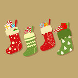 Christmas Socks With Presents Vector. Light Brown Background. Colorful christmas socks with presents and candy cane vector stock illustration