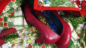 Red pumps on Christmas quilt Stock Images