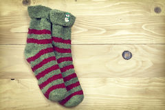 Christmas socks on rustic wooden background Stock Images