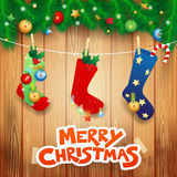 Christmas socks and text on wooden background Stock Image